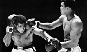 Muhammad Ali lands a right on Ernie Terrell in the fourth round of their heavyweight fight in 1967