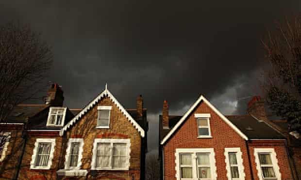 Dark sky above suburban houses