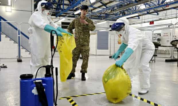 An army medic teaches NHS staff how to dispose of potentially contaminated waste
