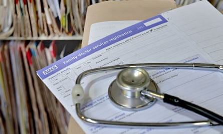 GP practice registration form and a stethoscope on a desk