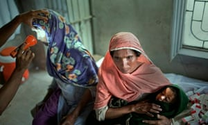 A mother and child and another young woman in Pakistan receive medical treatment