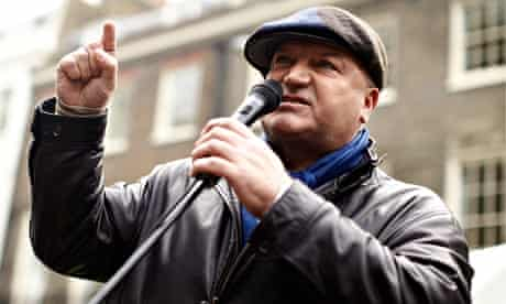 Bob Crow with microphone at a protest against government spending cuts in London in 2010