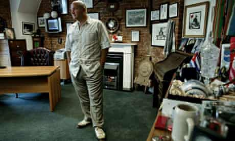 Bob Crow, general secretary of the RMT, standing in his office