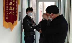 Friends of Chinese human rights activist Cao Shunli standing outside an intensive care unit