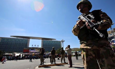 Police stand guard outside Kunming railway station