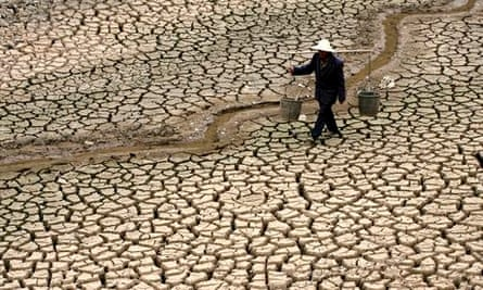 MDG : A Chinese farmer walks on a dry river bed in Yunnan province