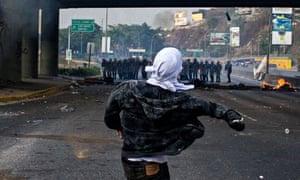 Protester confronts police in Caracasa, Venezuela