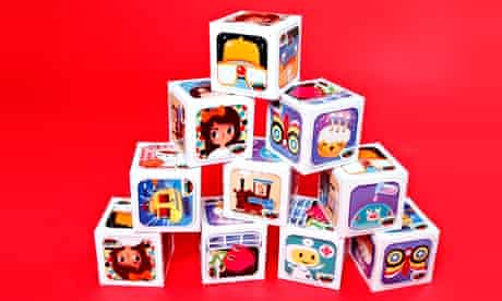 Pile of paper cubes with different images from Toca Boca apps on each face