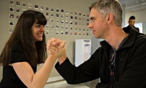 Melissa Bell armwrestling with Ryan Gantz, Vox Media's director of user experience