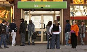People wait outside a jobcentre