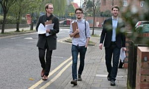 Henry de Zoete, Jonathan Senior and Will Hodson walking in street with clipboards