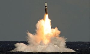 An unarmed Trident missile emerges from the surface of the sea