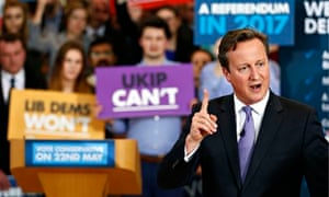 David Cameron delivers speech - placard waving Conservative supporters behind him