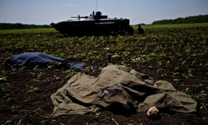 Bodies covered with blankets lie in a field near the village of Blahodatne, eastern Ukraine