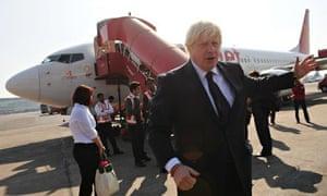 Boris Johnson about to board a plane