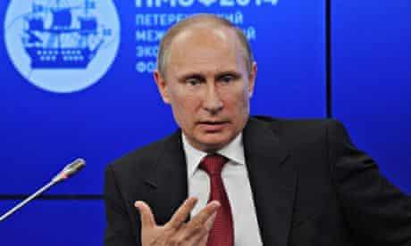 Russian president Vladimir Putin at microphone at the St Petersburg International Economic Forum