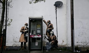 Possible Banksy Artwork Around A Telephone Box