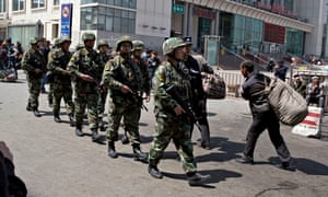 Chinese security forces after an explosion at a railway station in Urumqi, Xinjiang, in May.