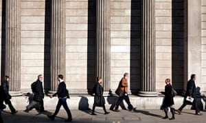 City workers outside the Bank of England building on Threadneedle Street in the City of London.