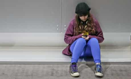 young girl texting cell phone sitting alone