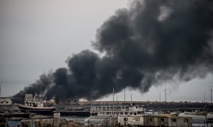 A building within the Gaza port on fire