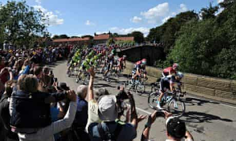 The leading riders pass over the bridge in West Tanfield, Yorkshire, in the 2014 Tour de France.