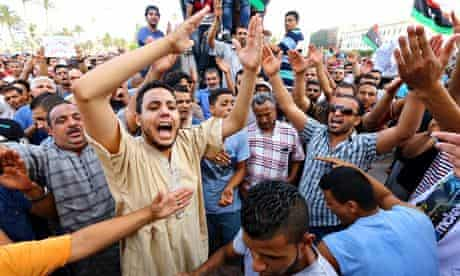 Libyans take part in a demonstration in