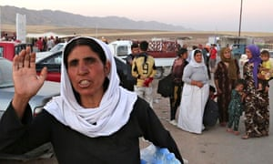 Iraqis from the Yazidi community near the Syria-Iraq border after fleeing Isis forces.