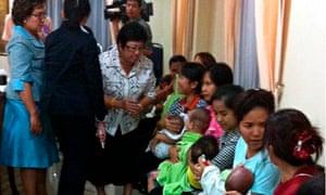 Thai nannies holding surrogate babies, Bangkok