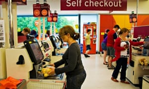 Customers using self service checkout at Sainsbury's