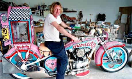 Grayson Perry with his bike Patience at his studio in East Sussex.