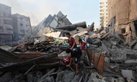 Children in rubble of Al-Basha Tower in Gaza