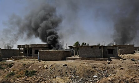 The homes of suspected Isis supporters are set ablaze in Zummar, northern Iraq.