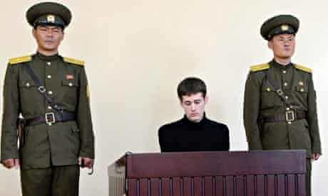 Matthew Miller sitting in dock, flanked by North Korean guards