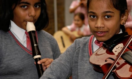 Schoolchildren playing the recorder and violin