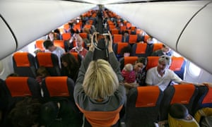 Easyjet flight attendant presents safety instructions to passengers