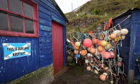 A yes sign is displayed on a fisherman's shack in St Abbs, Scotland