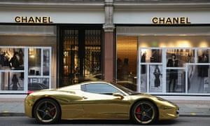 A gold Ferrari sits outside Chanel on Sloane Street, London