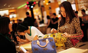 A woman shops in Louis Vuitton store in Shanghai, China