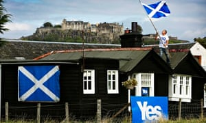 A Yes Scotland supporter decorates his home near Stirling Castle.