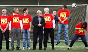 Former Celtic player Bertie Auld, dodges a free kick at a no campaign event.