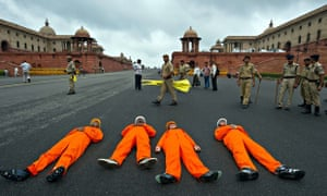 Greenpeace activists dressed as coal miners protest againstin New Delhi