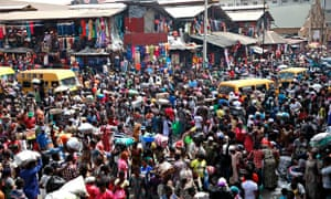 People gather at Balogun market in central Lagos