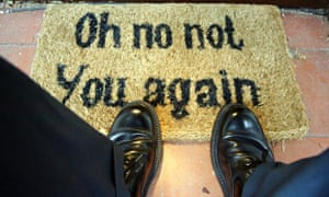 Feet on a doormat which reads Oh no not you again