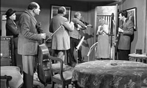 Katie Johnson's Mrs Wilberforce interrupts Professor Marcus and the gang in The Ladykillers: 'Gradually we come to sympathise with these craven scoundrels.'
