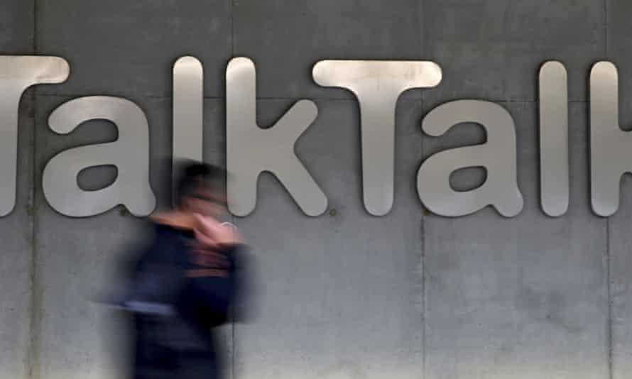 Man walks past company logo of TalkTalk