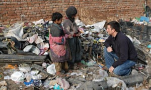 Marc Koska talks to two children at rubbish dump