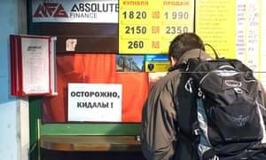 A man exchanges money in Kiev, Ukraine