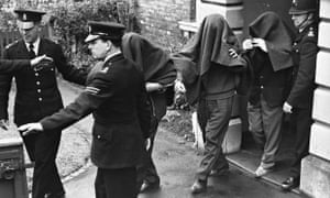 Three of the suspects arrested in connection with the 'Great Train Robbery', photographed leaving Linslade court with blankets over their heads.