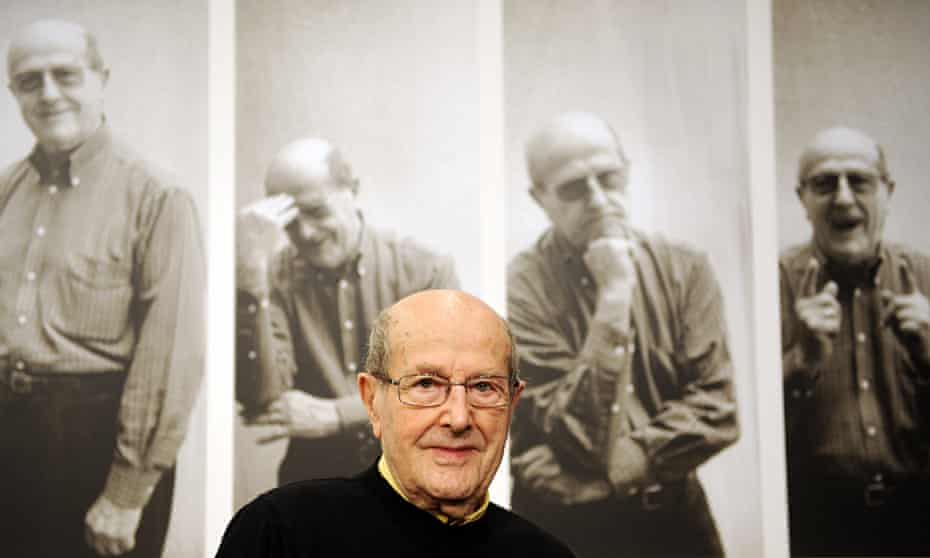 Manoel de Oliveira in front of a montage announcing an exhibition of his work in 2009 in Berlin